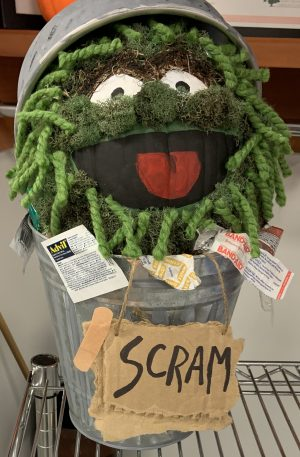 Oscar the Grouch in his trash can pumpkin image