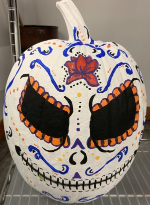 Pumpkin decorated to look like a day of the dead sugar skull