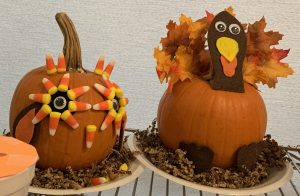 pumpkins decorated to look like a Turkey & Owl