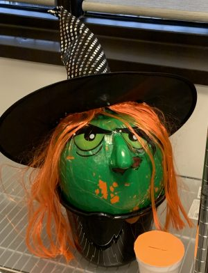 pumpkin painted to look like a witch
